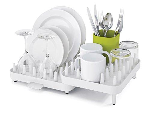 égouttoir à vaisselle en plastique solide blanc de taille ajustable, signé Joseph Joseph avec picots